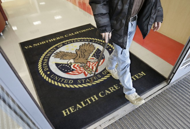 In this April 2, 2015, file photo, a visitor leaves the Sacramento Veterans Affairs Medical Center in Rancho Cordova, California. AP/Rich Pedroncelli, File