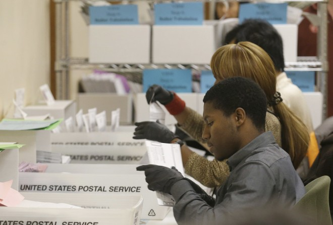 Department of Elections workers sort through mailed in ballots at City Hall in San Francisco, on Nov. 8, 2016. AP Photo/Jeff Chiu