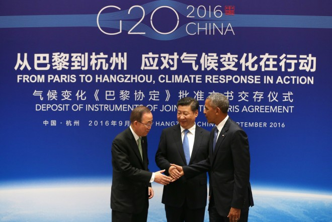 Chinese President Xi Jinping, center, U.S. President Barack Obama and U.N. Secretary-General Ban Ki-moon shake hands during a joint ratification of the Paris climate change agreement in eastern China's Zhejiang province, Sept. 3, 2016. How Hwee Young/Pool Photo via AP