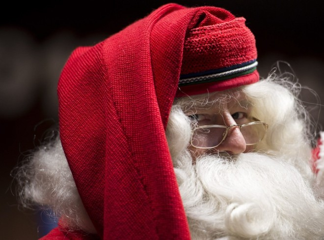 Parents go to great lengths to make their kids believe the Santa myth. Boglarka Bodnar/MTI via AP
