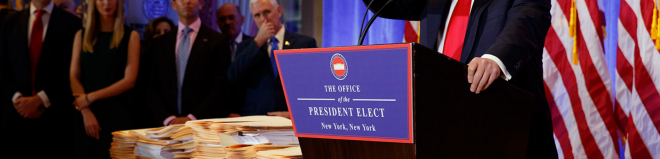 A pile of papers do not a conflict-of-interest plan make. Evan Vucci/AP Photo