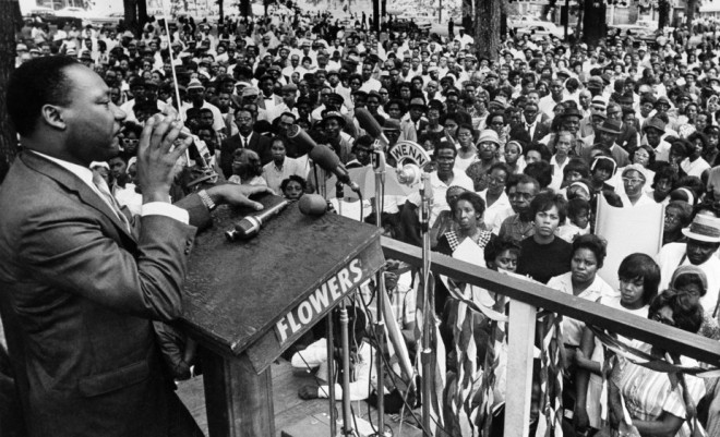 An April 30, 1966 file photo of King Jr. addressing a rally in Birmingham, Alabama, AP Photo/JT, File