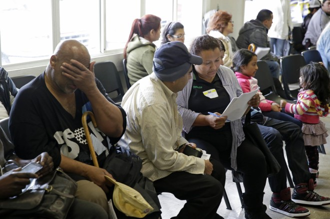 Applicants for insurance wait in Richmond, California in 2014. Eric Risberg/AP file photo.
