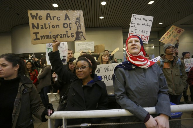 Activists in Portland, Oregon, protest President Trump's ban. Clinton Steeds/Reuters