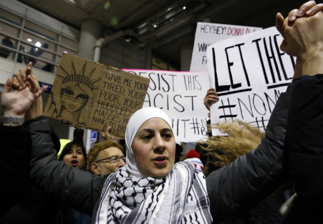 Demonstrators outside Terminal 5 of Chicago's O'Hare airport on Jan. 29, 2017. AP Photo/Nam Y. Huh