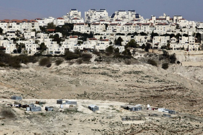 The Israeli settlement of Maaleh Adumim looms over Arab Bedouin shacks in the West Bank, Jan. 22, 2017. AP Photo/Mahmoud Illean