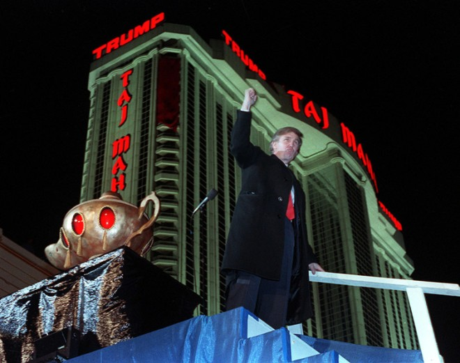 Trump celebrates the opening of his Taj Mahal Casino Resort in Atlantic City in 1990. Charles Rex Arbogast/AP Photo