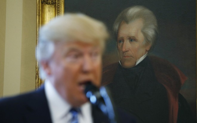 U.S. President Donald Trump speaks in front of a portrait of former U.S. President Andrew Jackson. REUTERS/Kevin Lamarque