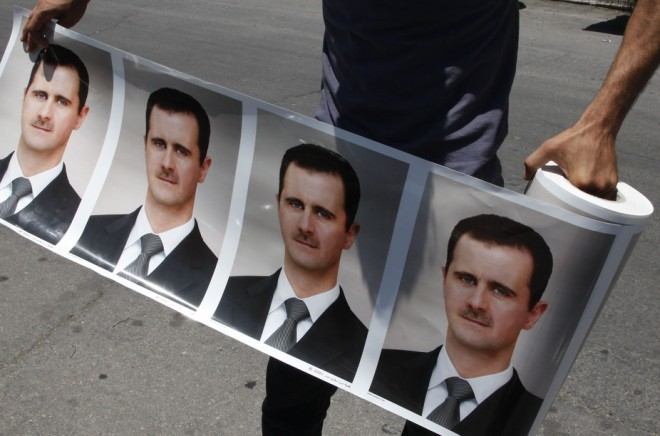 A roll of pictures of Syrian President Bashar al-Assad in Damascus. Reuters/Khaled al-Hariri