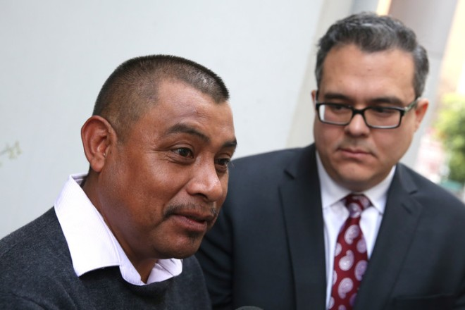 An asylum seeker outside immigration court with his lawyer in Los Angeles. REUTERS/Lucy Nicholson