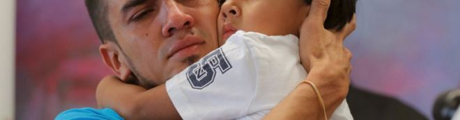 Father and son reunited after being detained in Texas. REUTERS/Lucas Jackson